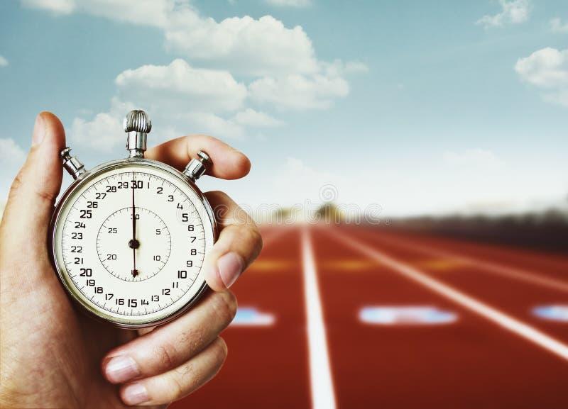 Hand holding sport chronometer stock image
