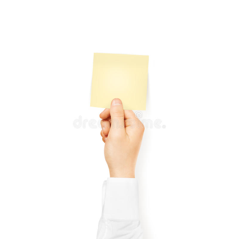 Hand holding square blank yellow sticker mock up isolated. Stick stock image