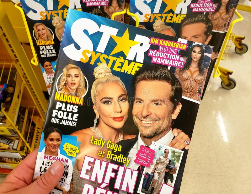 A hand holding Star Magazine. MONTREAL, CANADA - JUNE 20, 2019: A hand holding Star Magazine with Lady Gaga and Bradley Cooper on the cover. Star is American stock photos
