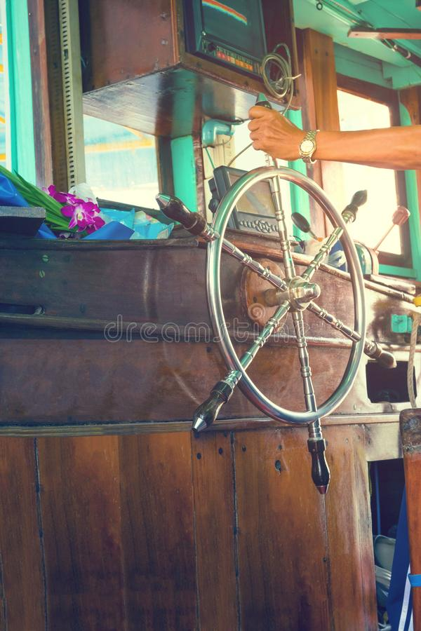 Hand holding steering wheel the fishing boat stock photos