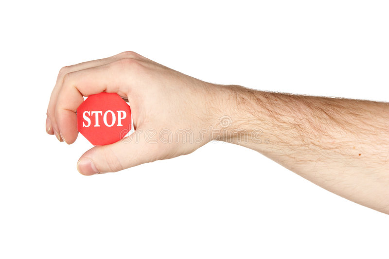 Hand holding stop sign. Isolated over white background royalty free stock image