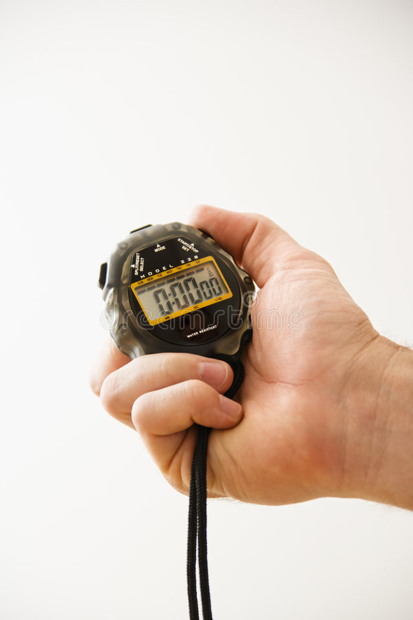 Hand holding stopwatch. stock photos