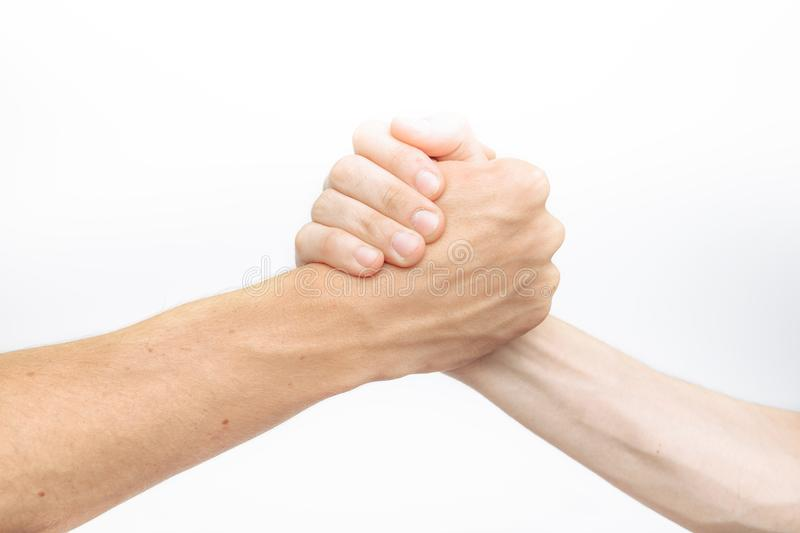 Hand holding, struggle between two, isolated on white background, for advertising, text insertion royalty free stock photo