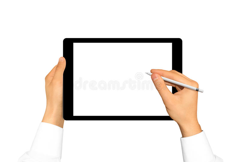 Hand holding stylus near graphic tablet blank screen. Empty tab. Display mock up isolated. Designer drawing, painting, sketching. New digitizer pencil royalty free stock image