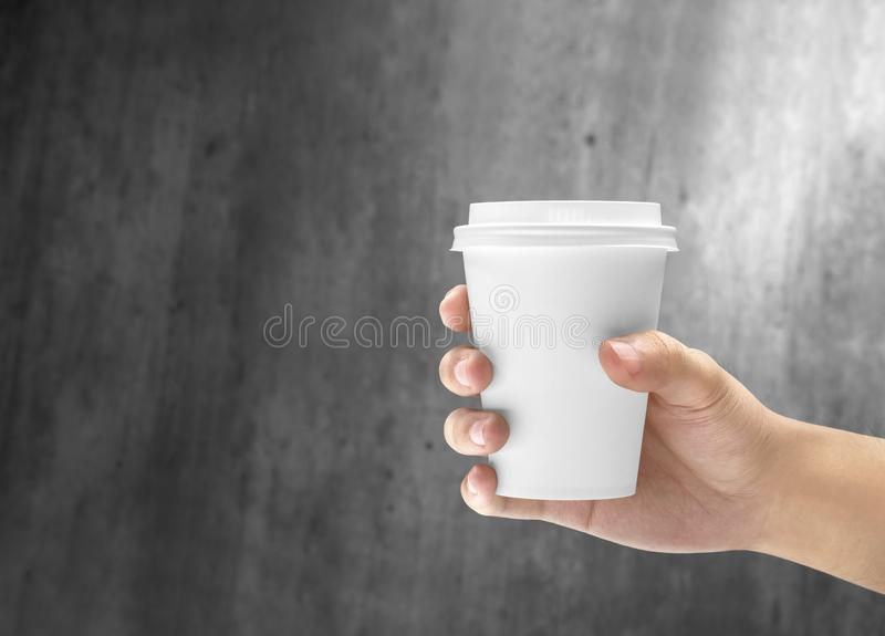 Hand holding a styrofoam cup of hot coffee stock image