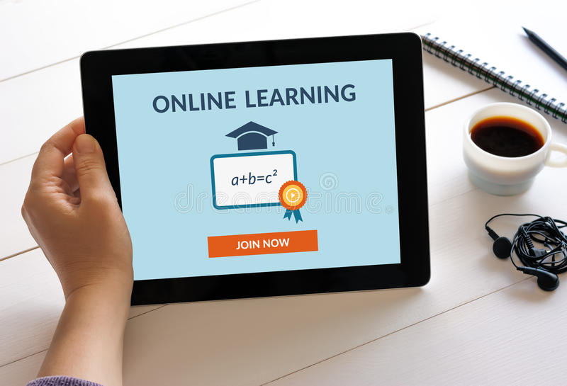 Hand holding tablet computer with online learning concept on scr stock photos