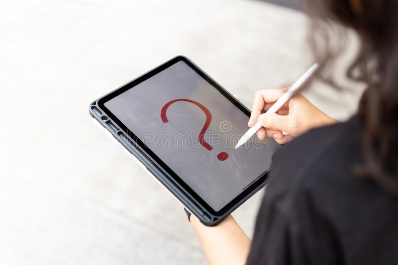 Hand holding tablet, empty space on display, image use for mobile applications and multimedia programs stock image