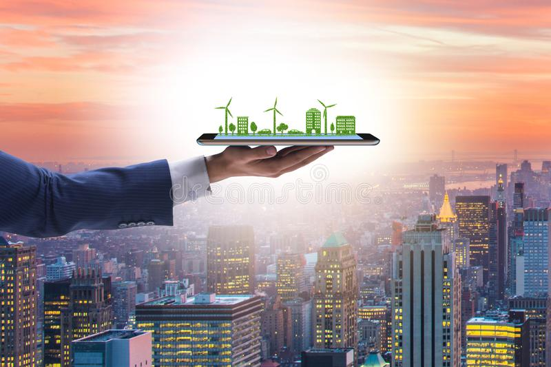 Hand holding tablet with mini ecosystem and clean energy. The hand holding tablet with mini ecosystem and clean energy royalty free stock image