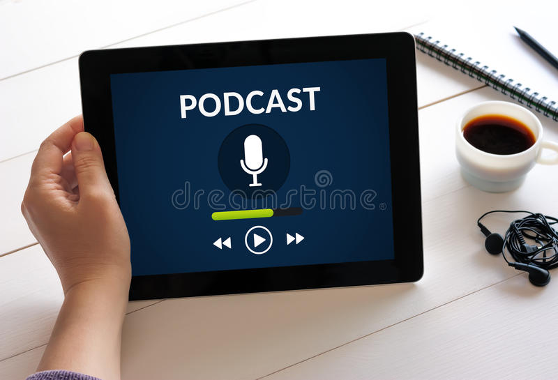 Hand holding tablet with podcast concept on screen. Hand holding digital tablet computer with podcast concept on screen. All screen content is designed by me stock photography