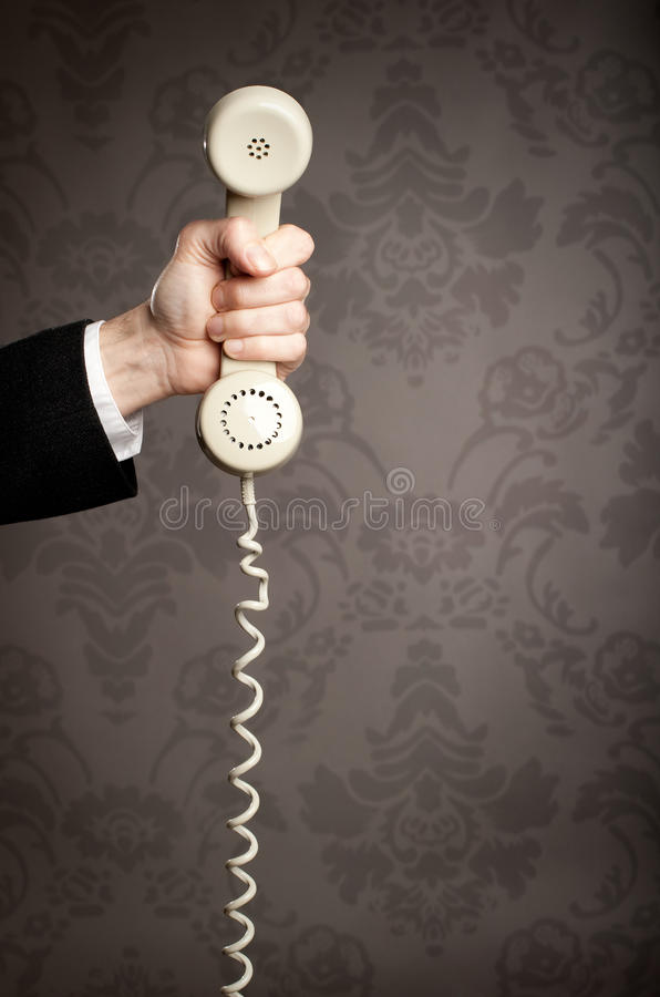 Hand holding telephone royalty free stock images