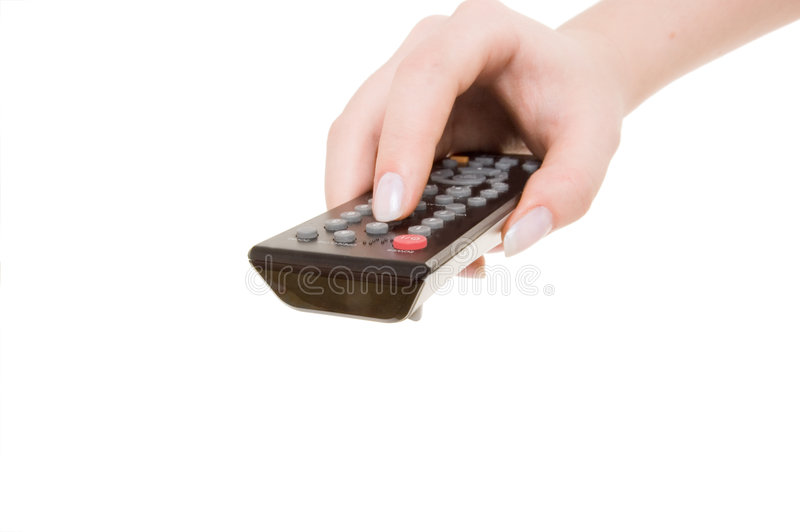 Hand holding television remote stock photo