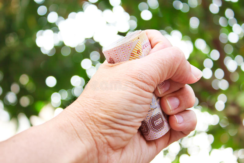 Hand holding thai money. stock photo