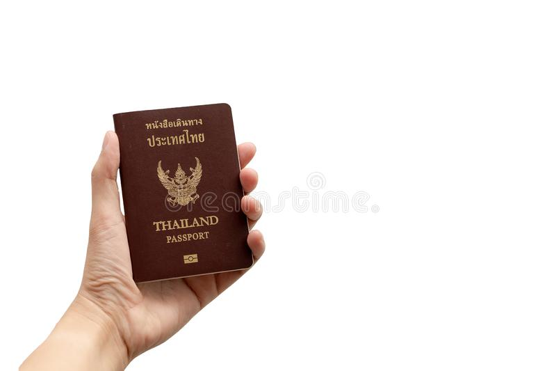 Hand holding Thailand passpor. Adult, asian, background, book, brown, business, citizenship, concept, country, document, documentation, homeland, id stock photos
