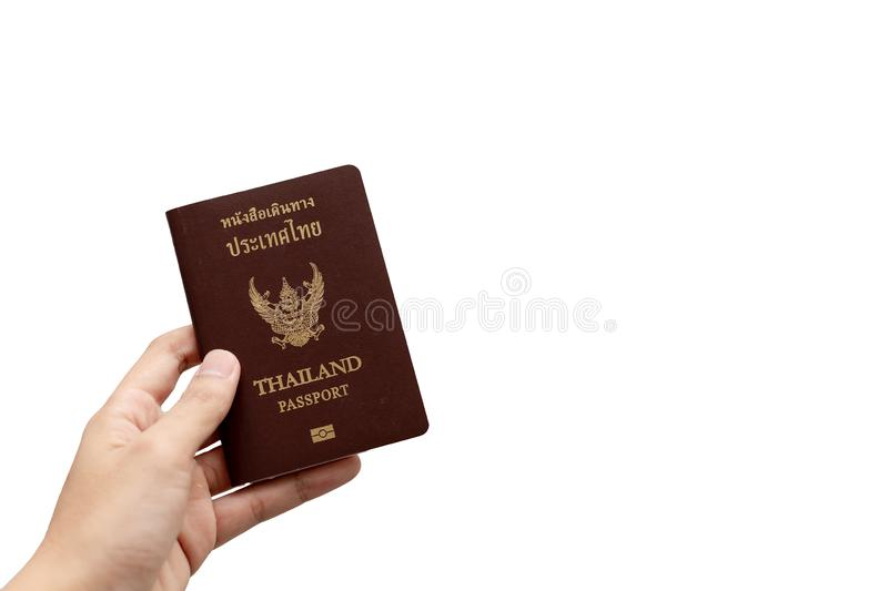 Hand holding Thailand passpor. Adult, asian, background, book, brown, business, citizenship, concept, country, document, documentation, homeland, id stock image
