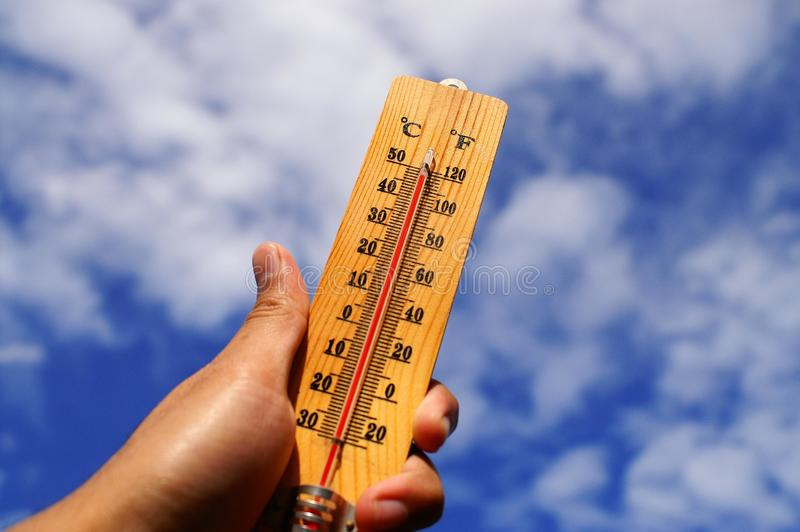 Download Hand Holding Thermometer stock image. Image of warm, earth - 13909783
