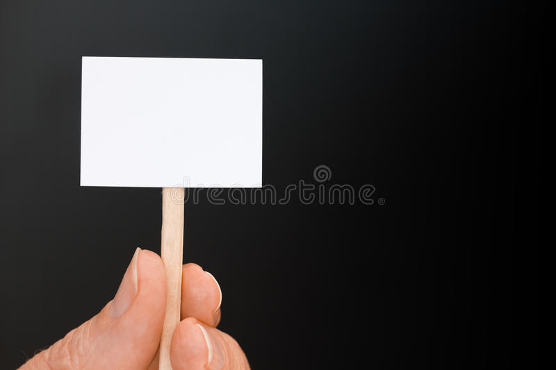 Download Hand Holding Tiny Sign On Black With Copy Space Stock Image - Image: 29286907