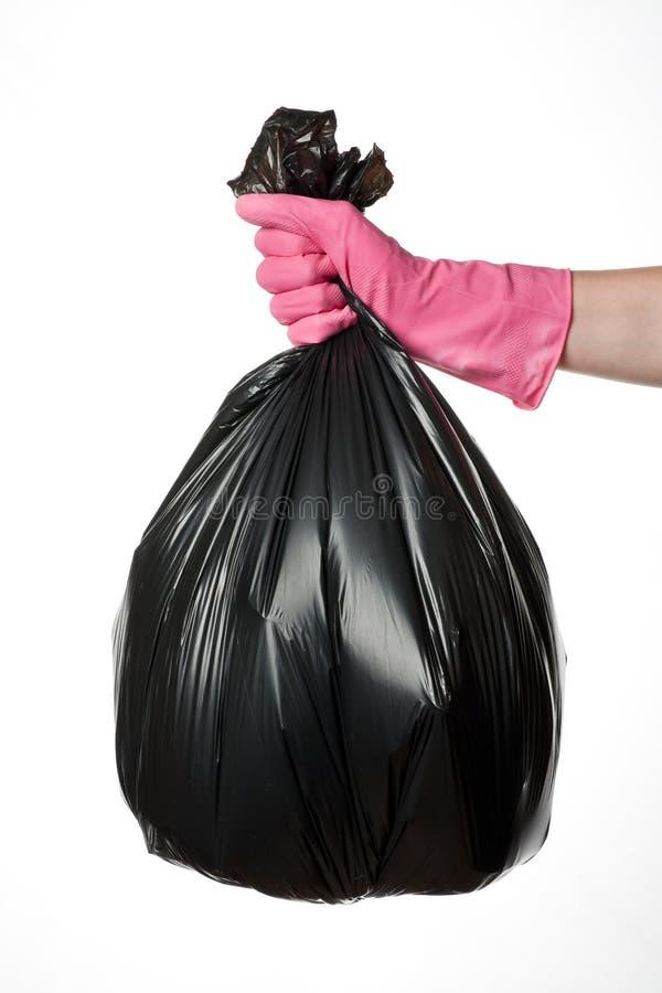 Hand holding trash bag stock photos