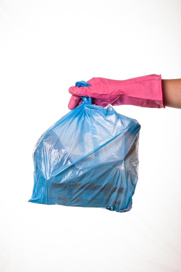 Hand holding trash bag royalty free stock photography