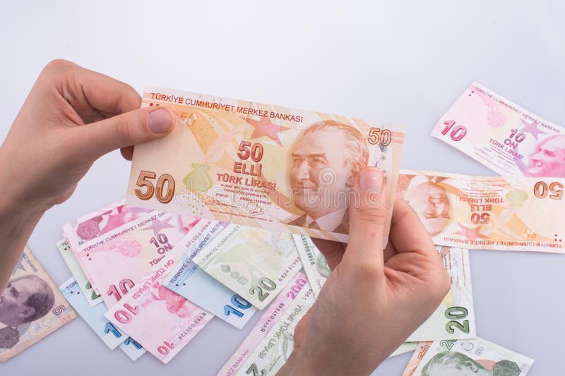 Hand holding Turksh Lira banknote in hand. Hand holding Turksh Lira banknote on white background stock images