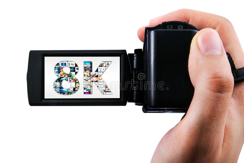Hand holding Ultra High Definition camcorder. Isolated on white stock photos