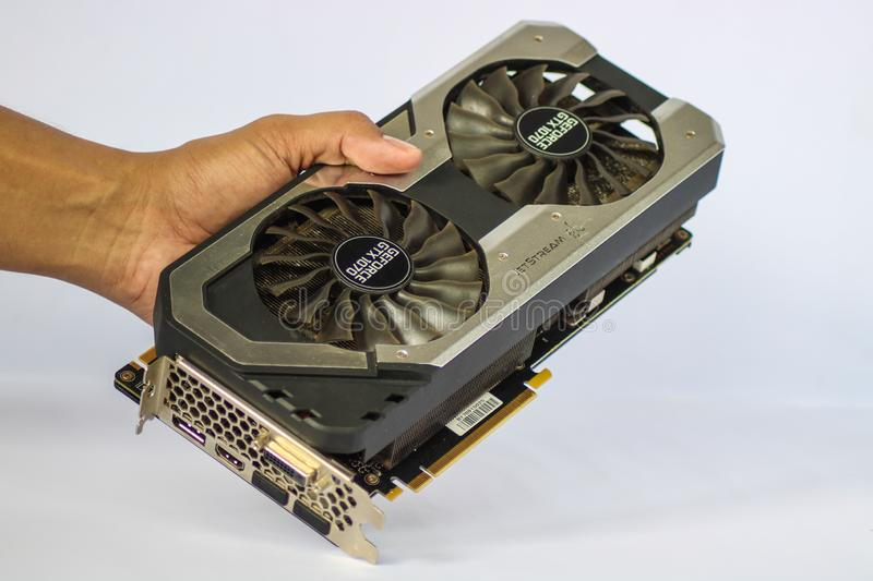 A hand holding a used Palit GeForce GTX 1070 Dual showing the front side of the Graphics Card Unit. CAMARINES SUR, PHILIPPINES - OCT 28, 2018: A hand holding a royalty free stock photo