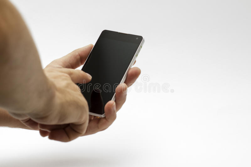 Hand holding and using a smartphone / phone (isolated) royalty free stock photo