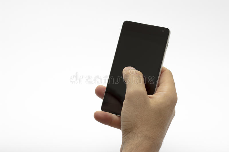 Hand holding and using a smartphone / phone (isolated) stock photo
