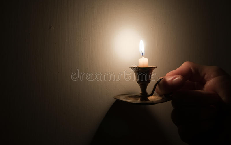 Hand holding vintage lamp stock photo