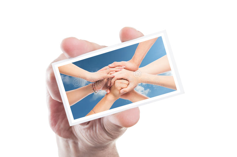 Hand holding volunteer card with joined hands as background royalty free stock photos