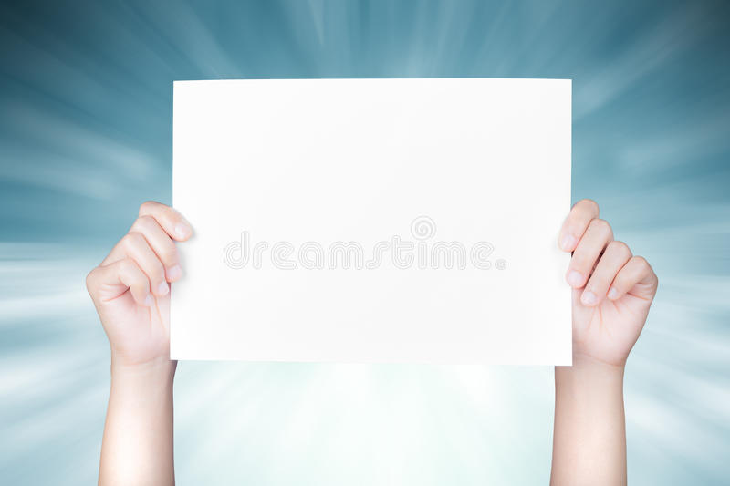 Hand holding white blank paper stock photography