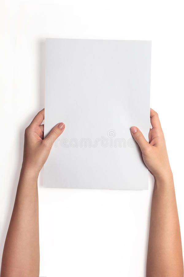 Hand holding white blank paper sheet mockup, isolated. Arm hold clear brochure template mock up. stock photography