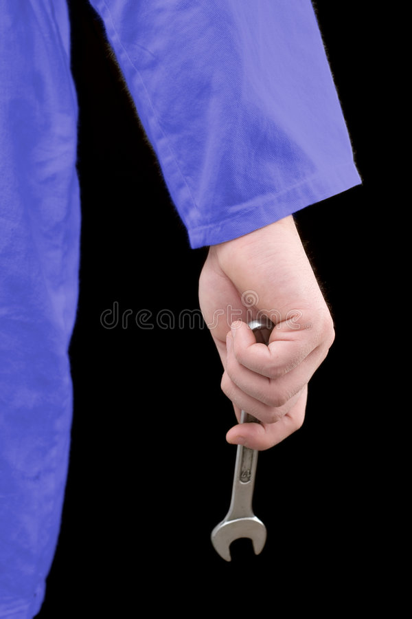 Hand holding a wrench stock image