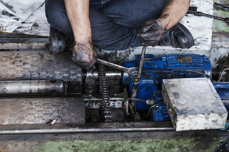 Hand holding a wrench and tighten and during maintenance work of royalty free stock image