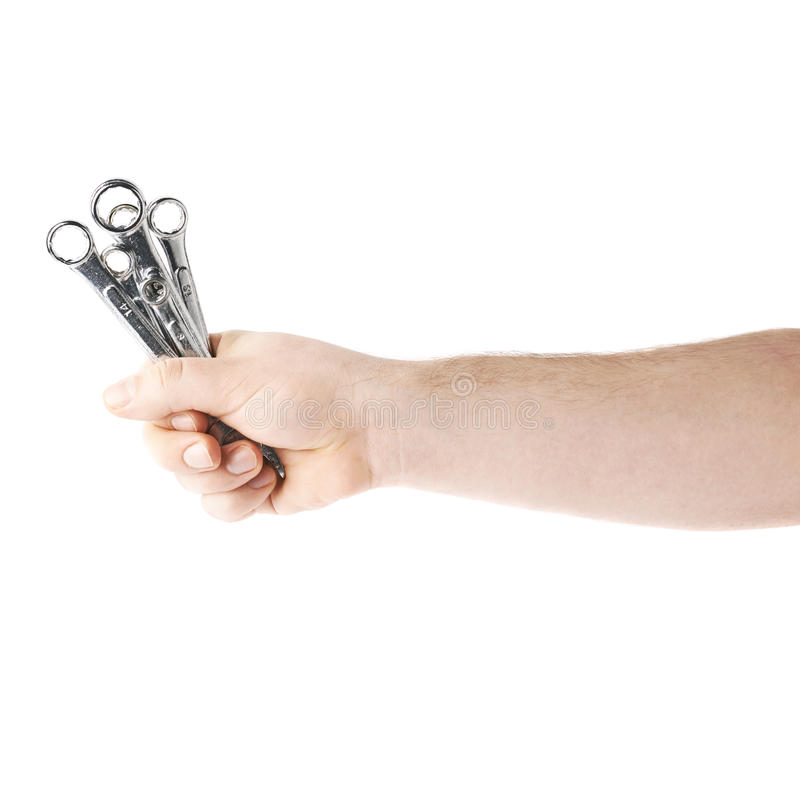Hand holding a wrench tools, composition isolated over the white background stock photography