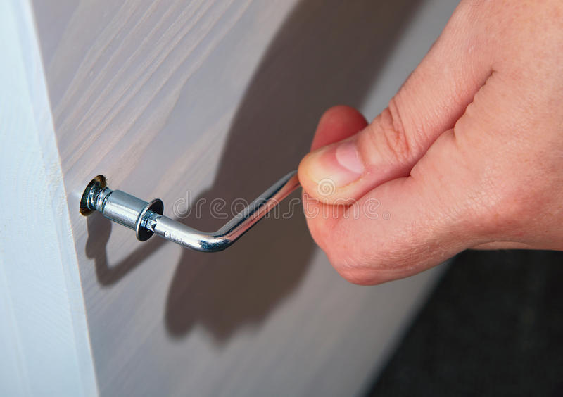 Download Hand Holds Allen Key Furniture Inserted Into The Bolt Head. Stock  Photo   Image