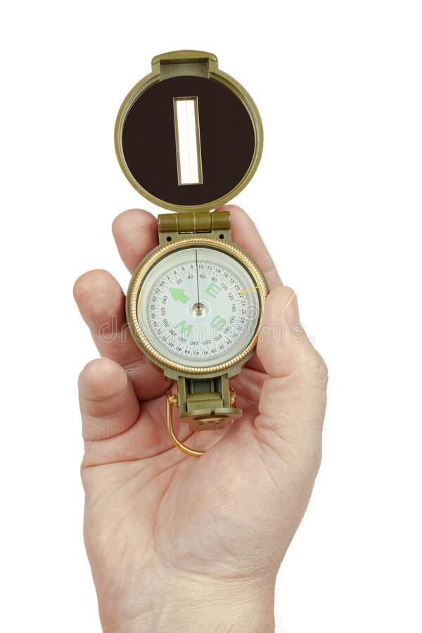 The hand holds the compass on a white background, isolate stock photos