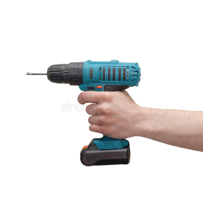 Hand holds cordless electric screwdriver with bit for screws isolated on white background.  royalty free stock image