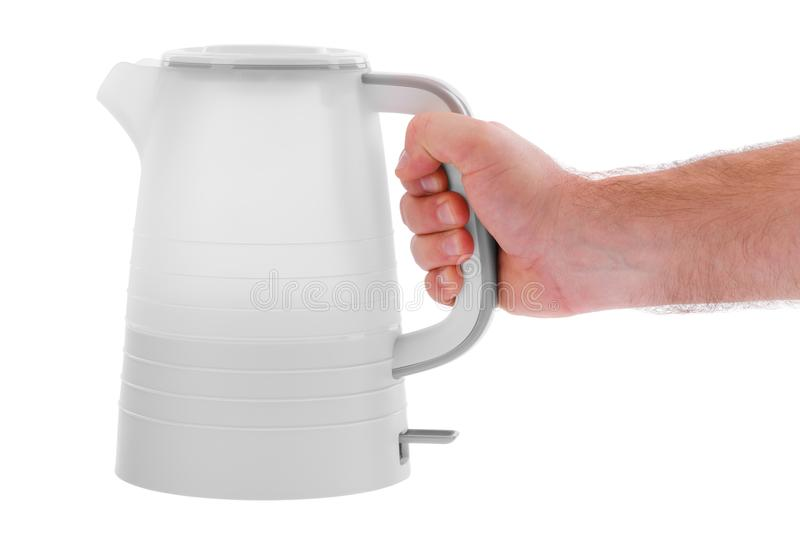 Hand holds an electric kettle plastic on a white isolated background stock photography