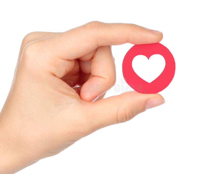 Hand holds Facebook Love Empathetic Emoji Reaction stock images