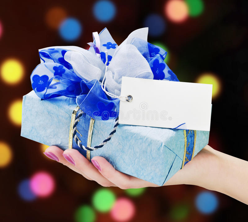 Hand Holds A Gift Royalty Free Stock Images