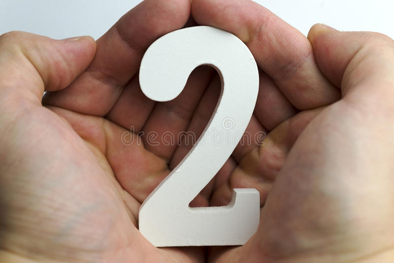 Hand holds the number two. royalty free stock photo