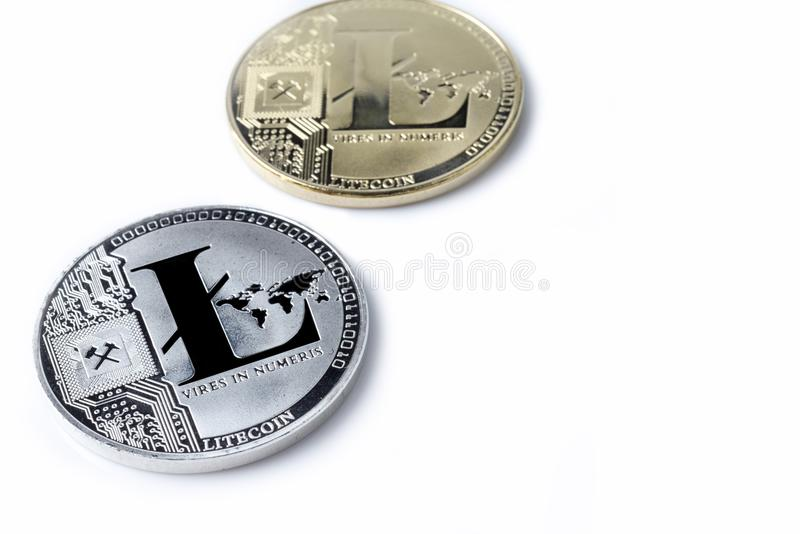 Hand holds one Litecoin on a white background. stock photo
