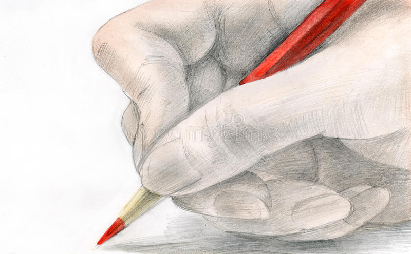 The Hand Holds A Pencil Royalty Free Stock Photos