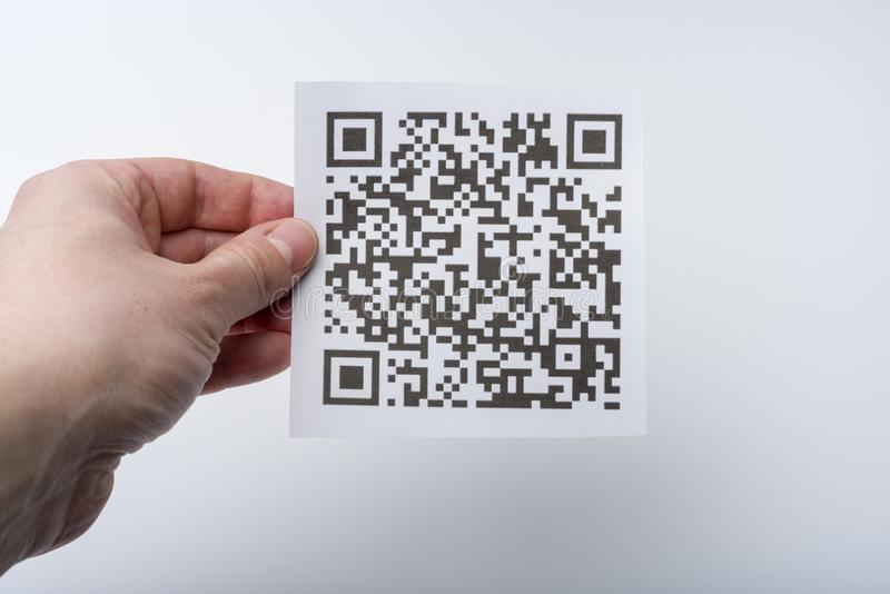 The hand holds the transaction code on a piece of paper stock images