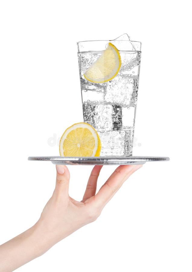 Hand holds tray with sparkling water soda drink stock images