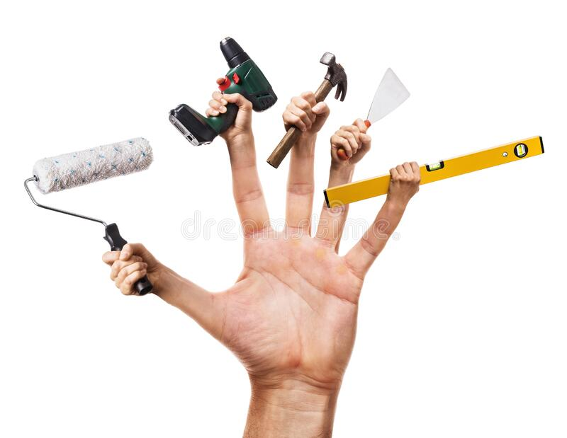 Hand holds various construction tools isolated. Concept handyman royalty free stock photos