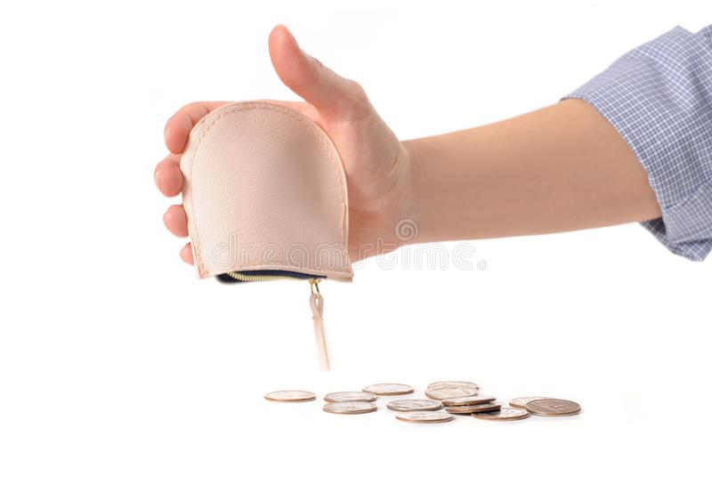 Hand holds the wallet and falling out metal coins. stock photography