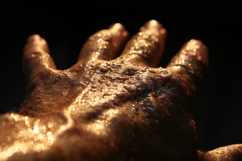 Hand horror. Hands of man with water droplets in the sun stock photo