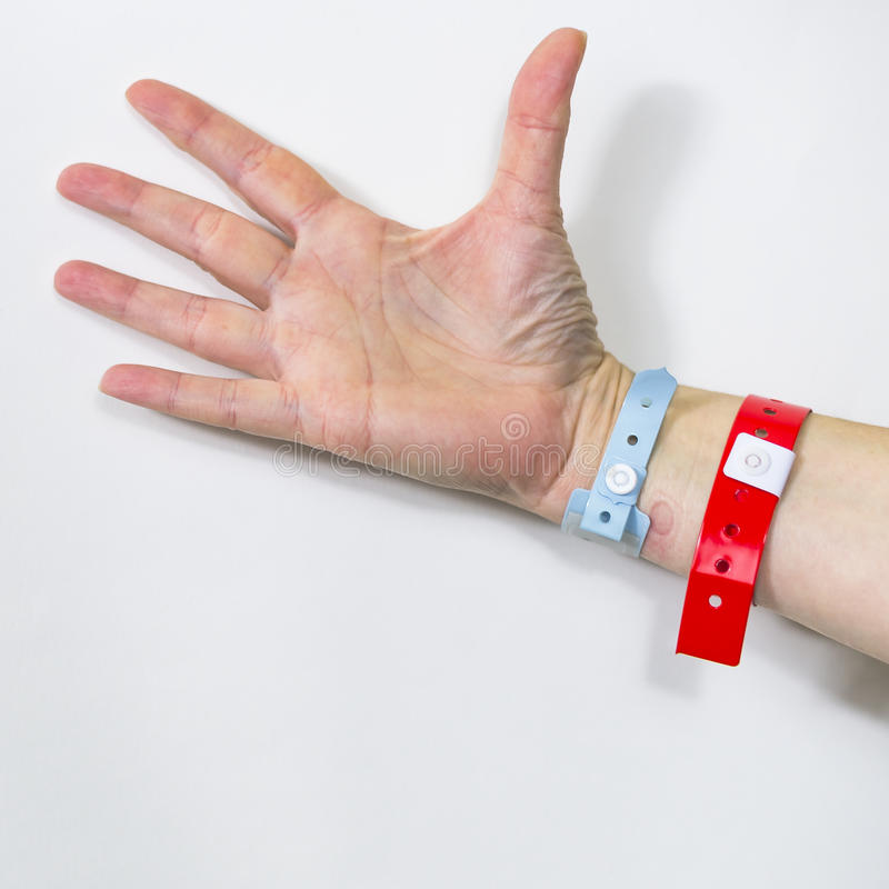 Hand With Hospital ID. Hand with The identifications bracelets of a woman in a hospital royalty free stock image