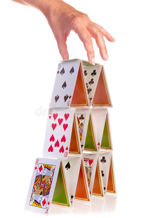 Hand and house of cards royalty free stock image
